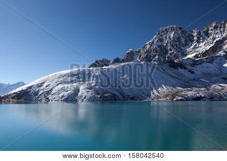 Beautiful Himalayan Mountain Range Reflecting In Ripples Of Gokyo Lake's Emerald Green Waters Under