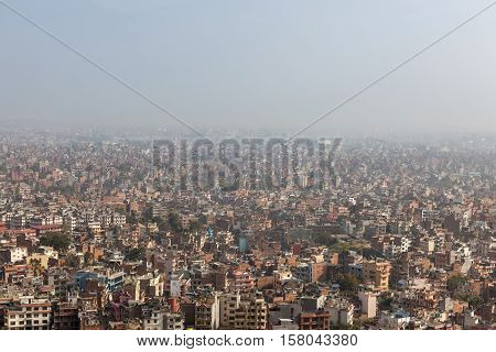 Aerial View Over The Nepalese Capital Kathmandu From Swayambhunath Temple. Big, Huge Asian City Cove