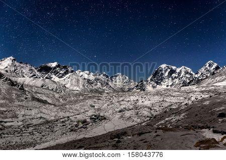 Panoramic View Over Gorak Shep Village On A Starry Night. Beautiful Night Mountain Landscape Under B