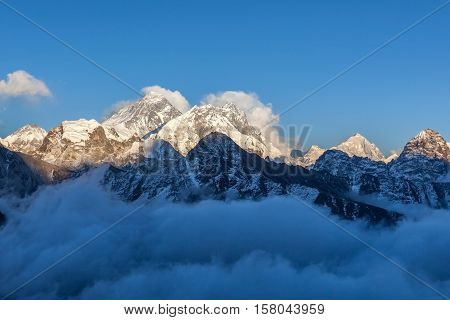 Mount Everest View From Gokyo Ri. Picturesque Mountain Valley Filled With Curly Clouds At Sunset. Dr