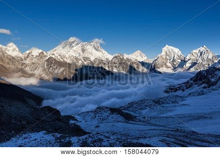 Mount Everest View From Renjo La Pass. Breathtaking Mountain Valley Filled With Curly Clouds. Dramat