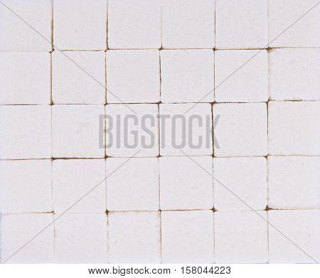 Closeup sugar cube background. food. white sugar cube
