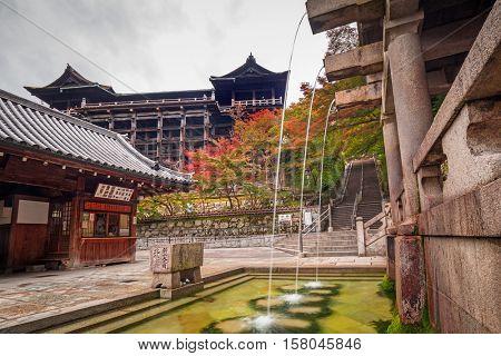 KYOTO, JAPAN - NOVEMBER 10, 2016: Three streams of Otowa waterfall at Kiyomizu-dera temple in Kyoto, Japan. Visitors believe that water have enhance health, longevity, and success in studies.