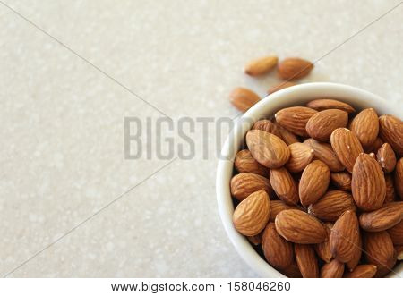 Almonds In Container On Kitchen Countertop, Positioned Off Bottom Right