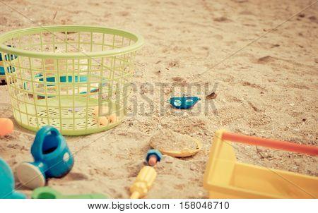 Basket of Children sandbox toy on a beach.