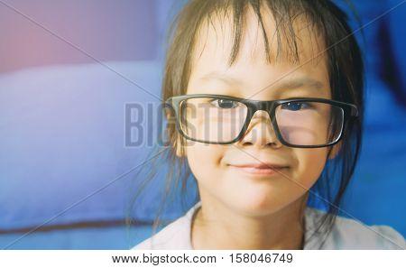 portrait of Asian Nerdy girl is wearing glasses