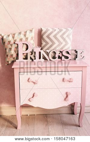 luxury girls pink chest of drawers dresser with pillows and word princess on the top close up photo