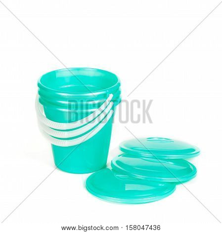 Green Plastic Buckets In A Pile With Covers
