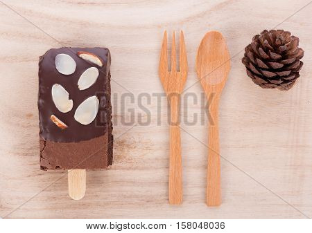 Closeup Brownie almonds on wooden background. food