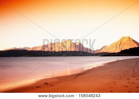 Northern Norway mountains with tidal waves long exposure landscape hd