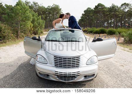 Beautiful Wedding Couple Posing Near Splendid Cabriolet Car