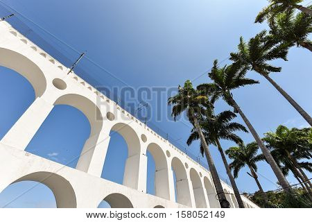 Carioca Aqueduct, Also Known as Arch of Lapa, in the Blue Sky, with Palm Trees, Rio de Janeiro, Brazil
