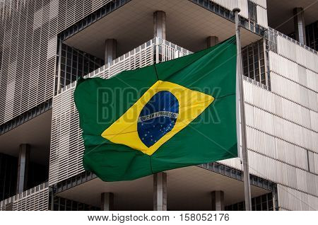 Brazilian Flag With Modern Building in the Background, Rio de Janeiro