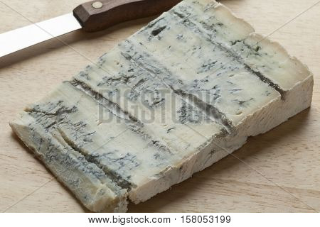 Piece of blue Gorgonzola cheese