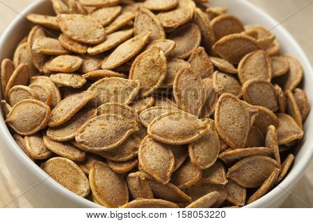 Bowl with spiced roasted pumpkin seeds