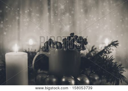 Christmas composition with cupfir banch,candles balls.New Year.Black and white.Toned