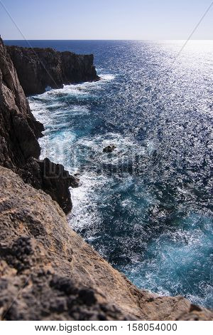 View on the sea and its abyss. Location Cala Domestica Sardinia Italy.
