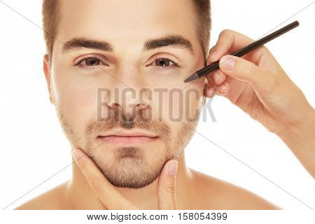 Plastic surgery concept. Female hand  marking face before operation