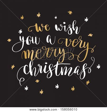 We wish you a very merry Christmas. Christmas greeting card with calligraphy. Handwritten modern brush lettering. White and gold quote on blackbackground