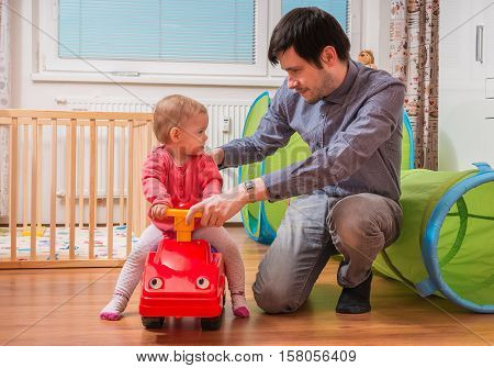 Young Father Is Playing With Daughter. Daddy Is Teaching His Chi
