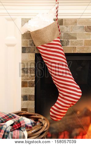 Christmas stocking hanging in front of a fireplace