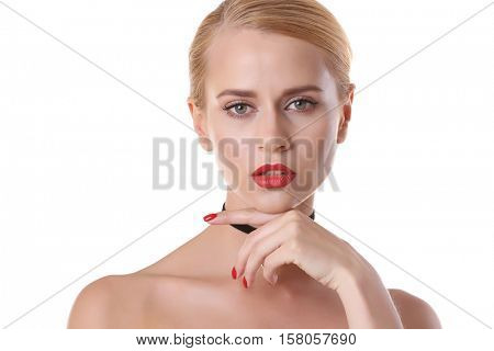 Portrait of beautiful woman with trendy choker on white background