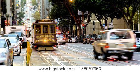 San Francisco CA USA october 22 2016; traditional Cable car in the traffic of San Francisco