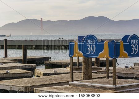 San Francisco CA USA october 23 2016; The famous Pier 39 in San Francisco with golden Gate bridge on the background