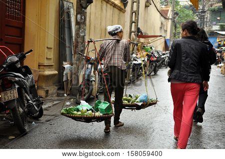 Street Vendor Selling Goods In Hanoi, Vietnam