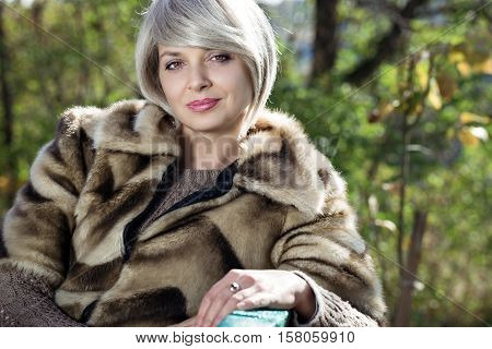 Portrait of beautiful girl close-up. Girl strolls in a park in autumn.