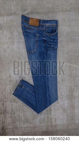 Side view blue jeans trouser isolated on the gray background