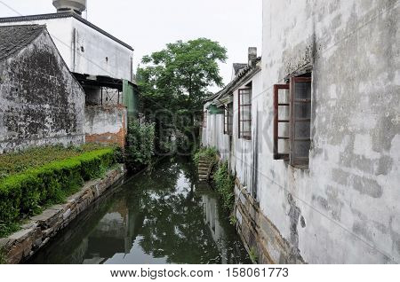 Chinese architecture and the water canals within Tongli Town scenic area in Jiangsu Province China.
