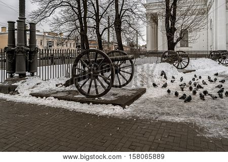 Old cannon imitations surrounding Glory Column in square in front of Holy Trinity Cathedral St Petersburg Russia.Original trophy cannons was dismantled in 1929 sold by Soviet Government to Germany for cash.