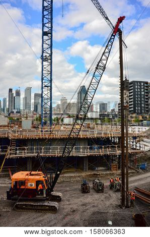MONTREAL CANADA - SEPTEMBER 02 2016:Construction workers erecting steel beam for residential building in Montreal downtown.Work is fast executed to comply with the booming market.