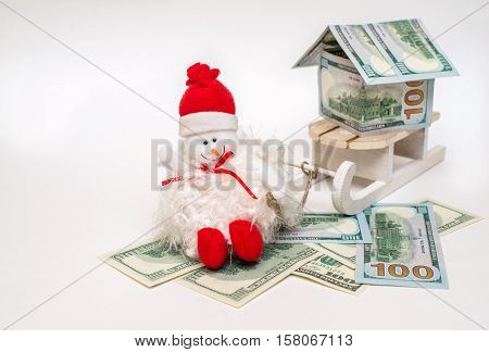 snowman on a sled driven home from the American currency
