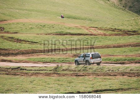 Kazbegi, Gergia - May 23, 2016: Mitsubishi Montero Sport SUV driving on off road in summer meadow. Mitsubishi Pajero Sport is a mid-size SUV produced by the Japanese manufacturer Mitsubishi Motors