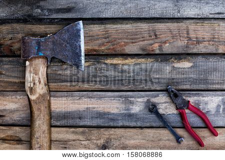 ax and other tools lying on the old boards