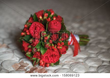Beautiful wedding bouquet on sofa background. Marriage concept