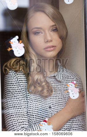 Cute Freckles Girl Behind Window