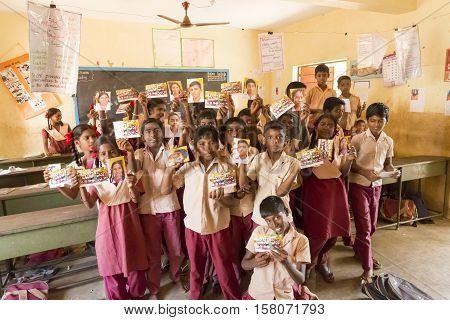 Pondichery, Tamil Nadu, India - Marsh 07 2014. Shool boys and girls with uniforms, in the class room. Happy for their picture of school, offered by a french photographer.