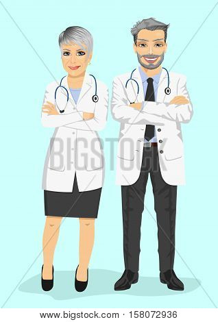 mature doctors standing with arms folded isolated on blue background