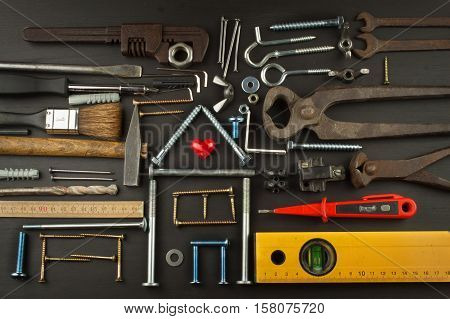 Plans for family living. Building a house for the family. Needed for building. Building components. Screws and tools for building. Planning for the construction of the house. Model House of components