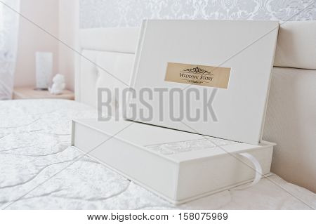 White Classic Photo Album Or Photobook With Golden Frame With Sign Wedding Story.