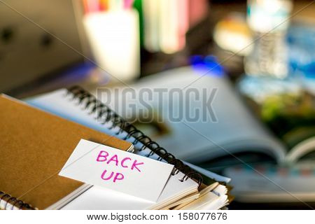 Back Up; Stack Of Documents And Laptop At Working Desk.