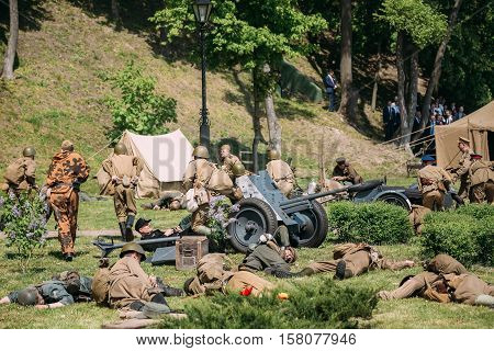 Gomel, Belarus - May 9, 2016: Russian Soviet And Wehrmacht Soldiers, Reenactors On The Battlefield After Battle. Scene Of Historical Reenactment Of WW2 Time, Celebrating Victory Day 9 May.