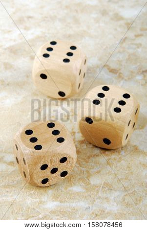close up of the dices on marble stone table