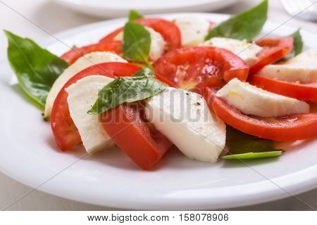 Healthy Classic Caprese Salad with Mozzarella Cheese, Tomatoes and Basil