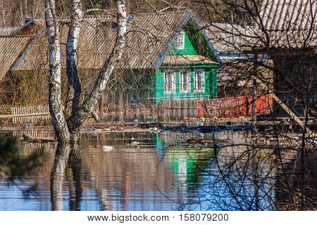 Flooded homes. Spring flood. Maksatikha 2013. Volchina river overflowed. Spring flood. Tver region.