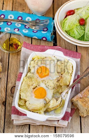 French style potato gratin with melted cheese and eggs