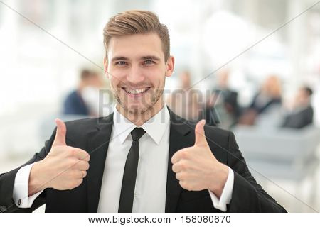 Portrait of happy smiling  business man showing thumbs up